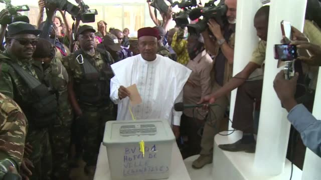 niger's president mahamadou issoufou casts his vote in the country's presidential election promising a knockout blow to the opposition one of whose... - mahamadou issoufou stock videos and b-roll footage