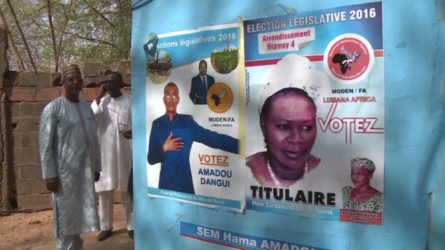 nigers presidential election will head to a run off with president mahamadou issoufou taking a clear lead against jailed opposition leader hama amadou - mahamadou issoufou stock videos and b-roll footage