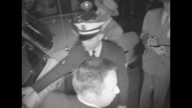 actor dick wesson gets out of convertible after arriving at the tennessee theatre for the film premiere of about face / africanamerican doorman in... - top hat stock videos & royalty-free footage