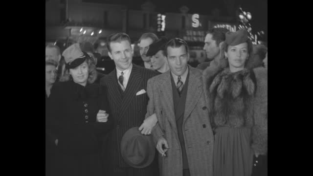 actress joan blondell and her husband, actor dick powell, arrive at the los angeles premiere of 'the hunchback of notre dame,' accompanied by writer... - hollywood california stock videos & royalty-free footage