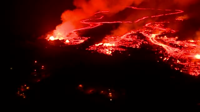 Night aerial BRoll of 2018 Kilauea Volcano Eruption Lower Puna area from a Hawaii Army National Guard UH60 Blackhawk aerial survey of the lava flow...