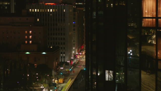 night aerial of empty downtown los angeles street during the covid-19 pandemic - lockdown stock videos & royalty-free footage