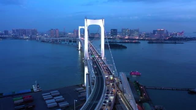night aerial view of a big bridge over the sea - 湾点の映像素材/bロール