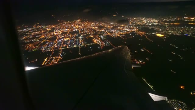 night aerial view of a plane over the city - pilot stock videos & royalty-free footage