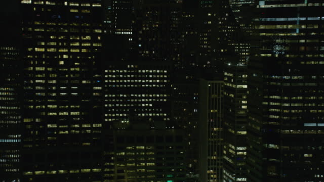 Night Aerial View Of Downtown Manhattan Buildings In New York City