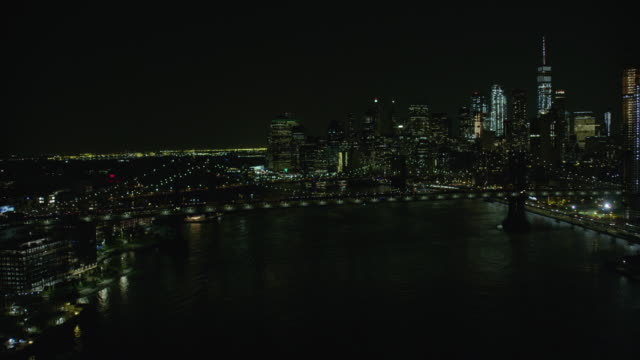 night aerial view of downtown manhattan, manhattan bridge and brooklyn bridge - east river stock videos & royalty-free footage