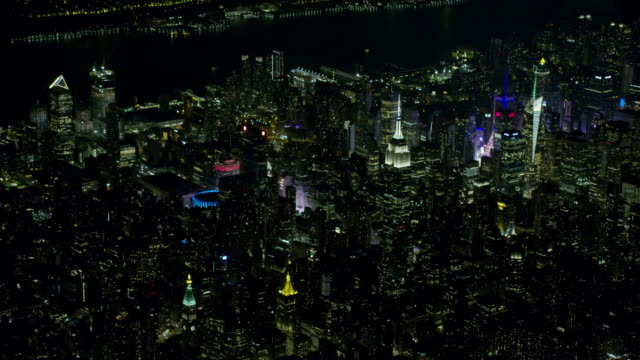 stockvideo's en b-roll-footage met night aerial view of new york city and midtown manhattan - hangbrug