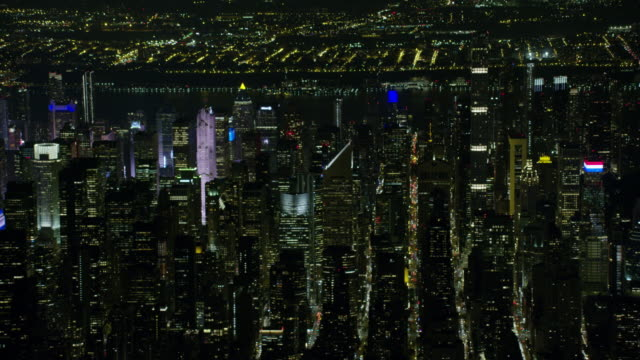 night aerial view of new york city and midtown manhattan - east river stock videos & royalty-free footage