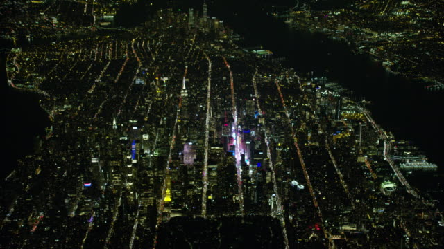 vídeos de stock, filmes e b-roll de night aerial view of new york city and times square - 1 minuto ou mais