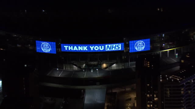 night aerial views of wembley stadium lit up blue in support of the nhs and medical workers fighting to keep us safe from the coronavirus on 26th... - wembley stock videos & royalty-free footage