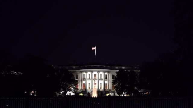 night architecture of white house in washington dc with us flag, district of columbia usa - white house washington dc stock videos & royalty-free footage