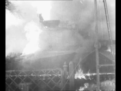 artillery guns fire in italy during world war ii / building burns / day: troops gather on rural road at us general mark clark's armored car / clark... - forze armate statunitensi video stock e b–roll
