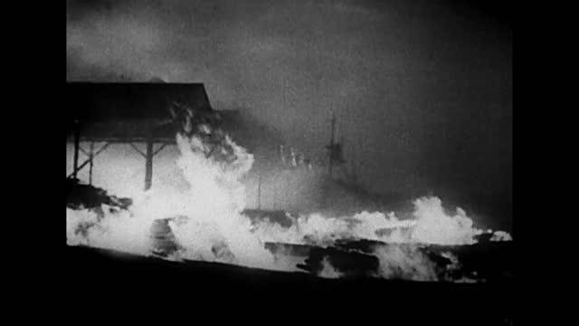 vidéos et rushes de night bombing of london / burning city / people in air raid shelter - 1940