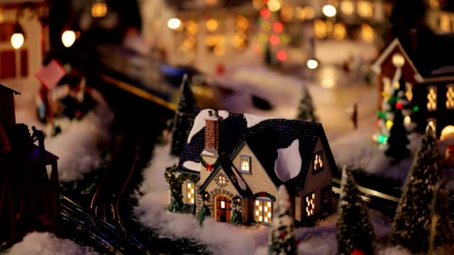 loopable night christmas winter wonderland village toy train (video) - village stock videos & royalty-free footage