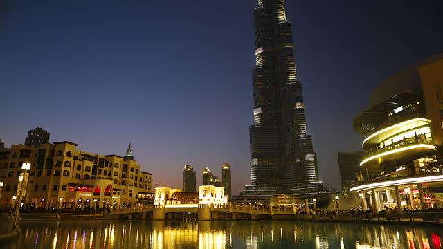 night city buildings and burj khalifa (khalifa tower) / dubai, united arab emirates - national landmark stock videos & royalty-free footage