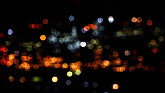 night city is defocused with nice bokeh. - ethereal stock videos and b-roll footage