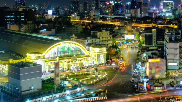 night city of bangkok railway station building in front of traffic located in bangkok thailand - railroad station stock videos & royalty-free footage