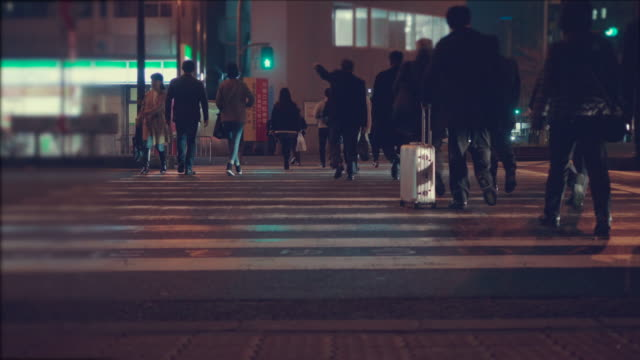 Night City. People crossing street. Crowded crosswalk. City life