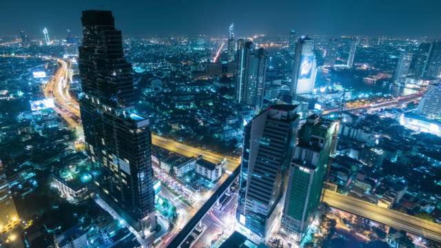 night city time lapse.panning left. - bangkok stock videos & royalty-free footage