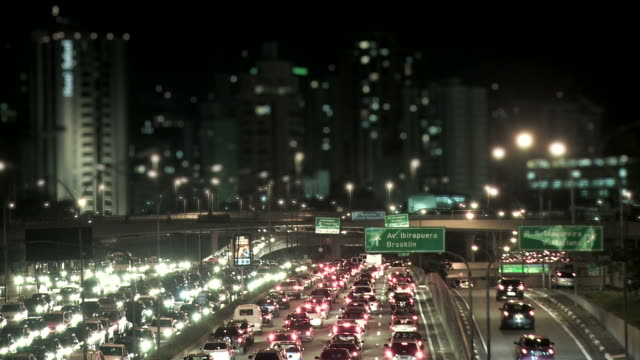 Night city traffic with defocused buildings in background