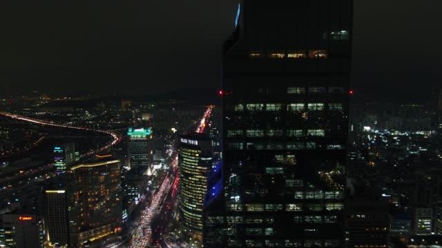 vidéos et rushes de night cityscape around coex (convention and exhibition center), seoul - panneau d'affichage