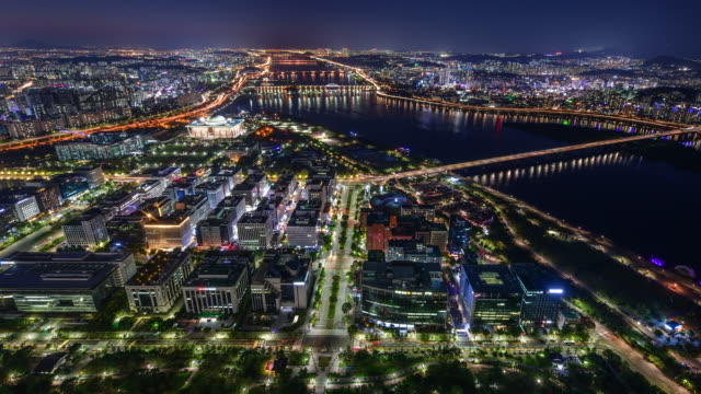 night cityscape around national assembly building and han river / yeouido, seoul, south korea - national assembly stock videos & royalty-free footage