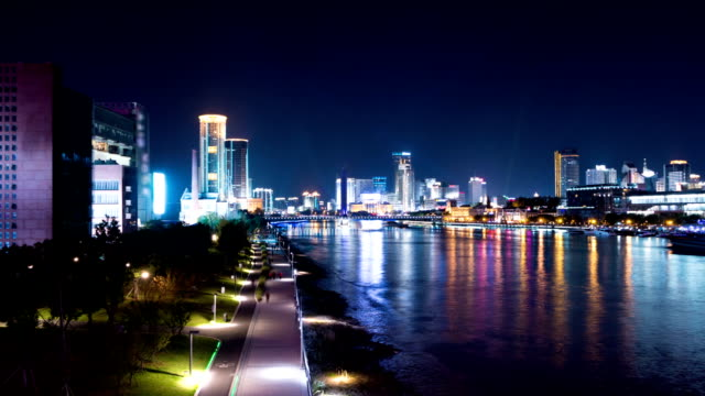 night cityscape at riverside,timelapse. - manchester england stock videos and b-roll footage