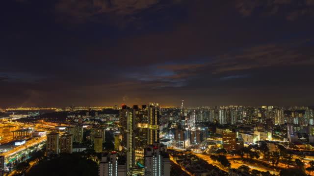 vídeos y material grabado en eventos de stock de night cityscape cerca de container industrial warehouse, singapur, night time lapse video - grulla de papel
