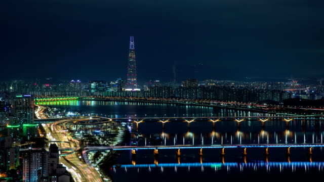 night cityscape of traffic on bridges over han river / seoul, south korea - wide stock videos & royalty-free footage