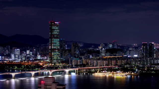 night cityscape of wonhyodaegyo bridge over han river / yeouido, seoul, south korea - anchored stock videos & royalty-free footage