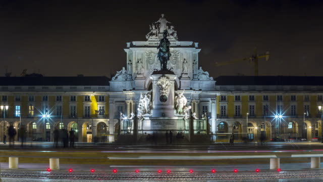 Night close-up timelapse of the Statue of King José I and Rua Augusta Arch at the Commerce Square. Lisbon, Portugal. April, 2017
