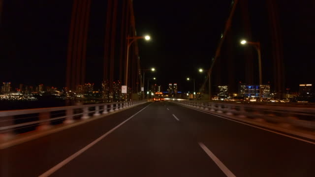 night drive / view of rainbow bridge, illuminated in red / tokyo alert - moving process plate stock videos & royalty-free footage