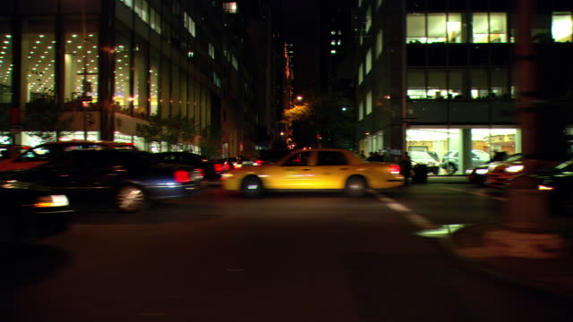 ds night driving down park avenue, with city buildings and heavy traffic at an intersection / new york city, new york, united states - median nerve stock videos & royalty-free footage