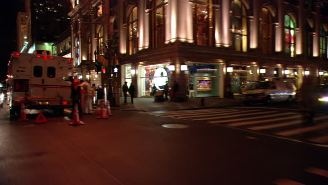 ds night driving in midtown manhattan, with upscale storefronts, pedestrians, and light traffic / new york city, new york, united states - ladenschild stock-videos und b-roll-filmmaterial