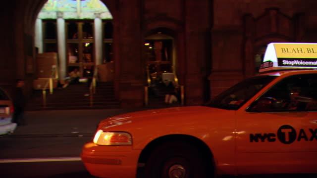 CPOV / TS / SIDE / FRONT VIEW / Night Driving Through Manhattan / New York City / NY NY