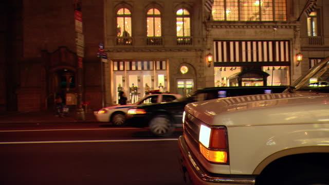 CPOV / TS / SIDE VIEW / Night Driving Through Manhattan / New York City / NY NY