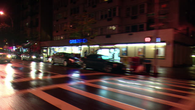 cpov / side / rear view / night driving through manhattan / new york city / ny ny - yellow taxi stock videos & royalty-free footage