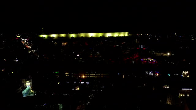Night Drone Footage above a Rooftop Bar on top of a Building in Saigon, Vietnam
