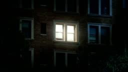 Night Establishing Shot of Office Windows Lights Turning On and Off