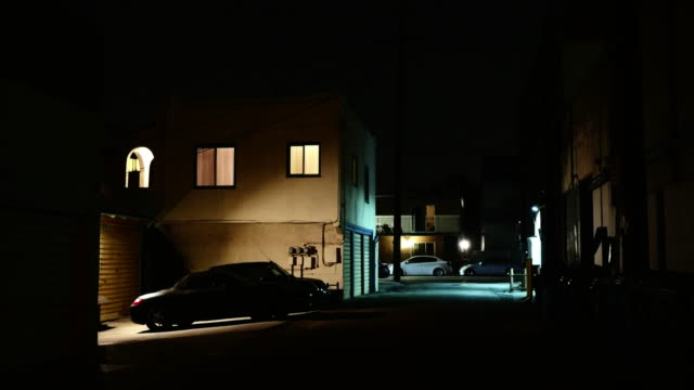night exterior apartments with alley and street - alley stock videos & royalty-free footage