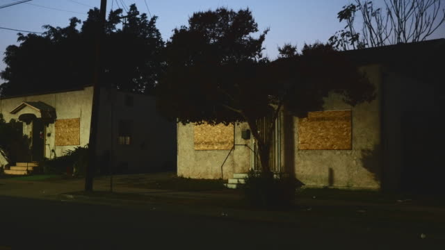 Night Exterior Boarded Up Single Family Apartments