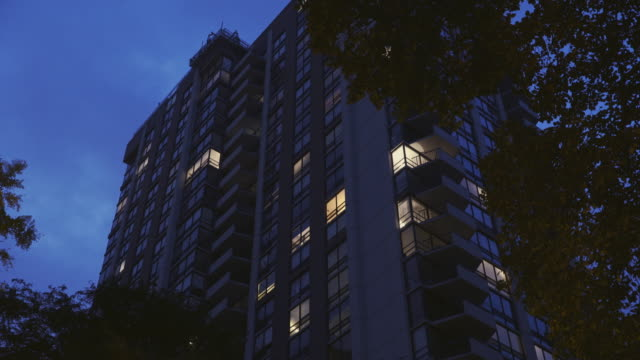night exterior luxury high-rise - flat stock videos & royalty-free footage