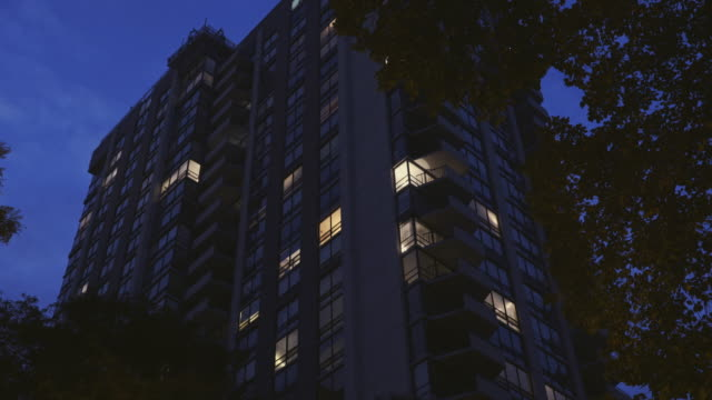 night exterior luxury high-rise - flat stock videos and b-roll footage