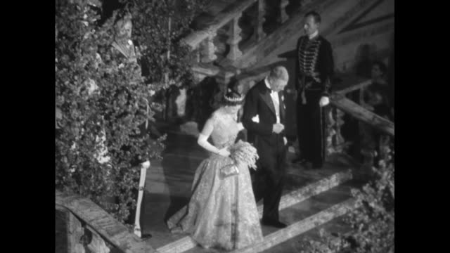night exterior of royal palace, stockholm / exterior of stockholm city hall / various shots of queen elizabeth ii & philip, duke of edinburgh,... - dressing up stock videos & royalty-free footage