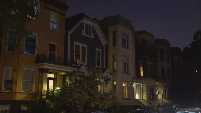 night exterior row of three flat apartments - row house stock videos & royalty-free footage