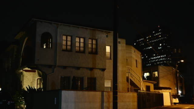 night exterior spanish colonial revival style residences and modern office buildings - flat stock videos & royalty-free footage