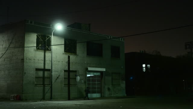 night exterior warehouse district - stange stock-videos und b-roll-filmmaterial