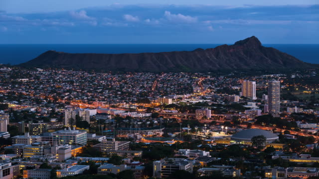 t/l night falls on downtown honolulu and diamond head crater - honolulu stock videos and b-roll footage