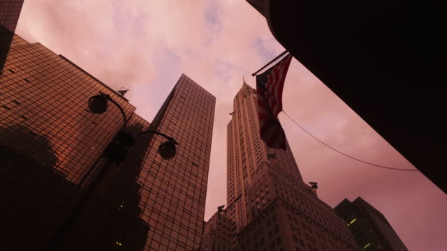 night falls over the empire state building, ny city - manhattan stock videos and b-roll footage