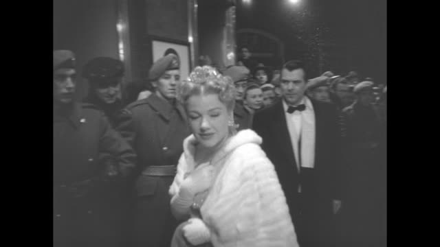 MS film star Anne Baxter walks toward entrance of the Capitol Theatre briefly turns to look behind her and then proceeds to the theater for the...